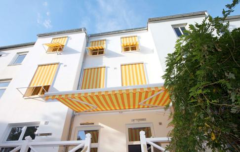 Kombiner vindues og terrassemarkise